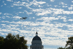 Space Shuttle Endeavour. SACRAMENTO, CA - September 21, 2012: Space Shuttle Endeavour flies over California state capital building on it's way to  California Royalty Free Stock Photography