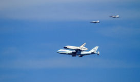 Space Shuttle Endeavour's Last Ride. The Space Shuttle Endeavour flies ontop a 747 for it's last ride to Los Angeles CA. Two training jets accompany the shuttle Stock Photos