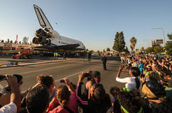 Space Shuttle Endeavour on streets of Los Angeles. With crowds watching, the Endeavour is towed along Crenshaw Boulevard in Los Angeles toward its new home at Stock Photography
