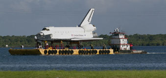 Space Shuttle Explorer. Space shuttle orbiter replica of Explorer travelling on barge through Port Canaveral heading to the Space Center in Houston, Texas, U.S.A Stock Image