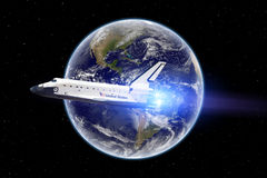 Space shuttle flight - Elements of this image furnished by NASA. Space shuttle flying over our earth Stock Image