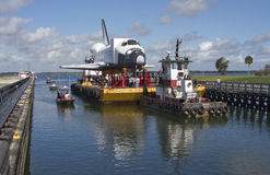 Space shuttle orbiter Explorer. Space shuttle orbiter replica of Explorer travelling on barge through port Canaveral heading to the Space Center in Houston Royalty Free Stock Images