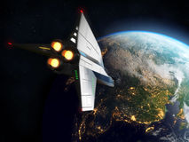 Space Shuttle Orbiting Earth. Elements of this image furnished by NASA. Stock Photography