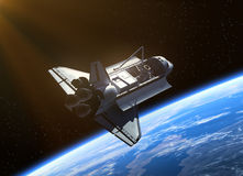 Space Shuttle Orbiting Earth. Royalty Free Stock Photo