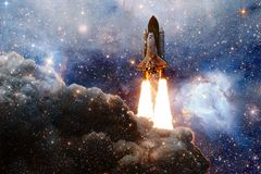 Space shuttle taking off on a mission. Deep space. Beauty of endless universe. Elements of this image furnished by NASA stock illustration