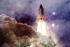 Space shuttle taking off on a mission. Deep space. Beauty of endless universe. Elements of this image furnished by NASA royalty free stock photography