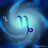 Space spiral with astrological Capricorn symbol Stock Images