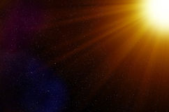 Space Stars and Light Rays Background. Dense background of stars seen through the light rays of a close star Stock Image
