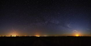 Space with the stars of the Milky Way in the night sky. Panoramic view is photographed on long exposure Royalty Free Stock Photos
