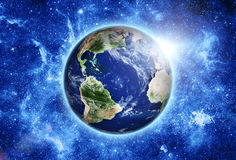 Space station over blue planet earth in space. Royalty Free Stock Images
