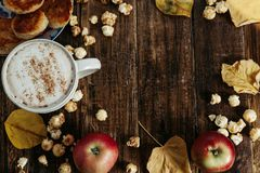 Space for text. Hot cocoa coffee with popcorn, apple, cakes, l Stock Photo