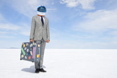 Space Tourist Businessman Traveling on Moon Voyage with Suitcase. Space tourist businessman astronaut traveling with suitcase on aerospace voyage to dramatic Royalty Free Stock Images