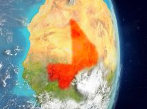 Orbit view of Mali in red. Space view of Mali highlighted in red on planet Earth with atmosphere. 3D illustration. Elements of this image furnished by NASA Royalty Free Stock Photo