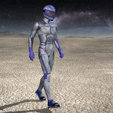 Space voyager walking on a planet Royalty Free Stock Photography