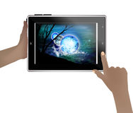 Space wallpaper on a tablet in human hands. Stock Photography