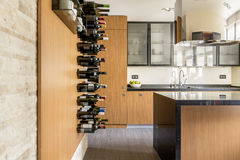Space for the wine. In modern wooden kitchen stock photography
