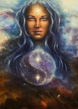 Space woman goddess Lada as a mighty loving guardian, with symbo. Beautiful painting on canvas of a space woman goddess Lada as a mighty loving guardian, with Stock Photography