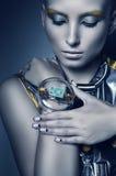 Space woman touching bracelet Stock Photos