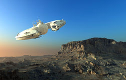 Spacecraft. Over the mountainous terrain of the planet Royalty Free Stock Photography