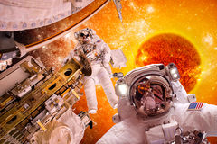 Spacecraft and astronauts in space on background sun star. Elements of this image furnished by NASA stock images