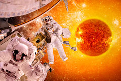 Spacecraft and astronauts in space on background sun star. Elements of this image furnished by NASA royalty free stock image