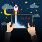 The spacecraft crashes outside tablet screen. Vector illustration. Concept of business start-up. Stock Photo