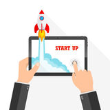 The spacecraft crashes outside tablet screen. Vector illustration. Concept of business start-up. Stock Image