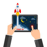 The spacecraft crashes outside tablet screen. Vector illustration. Concept of business start-up. Royalty Free Stock Images