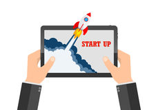 The spacecraft crashes outside tablet screen. Vector illustration. Concept of business start-up. Royalty Free Stock Photo