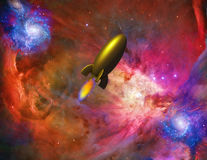 Spacecraft. Retro look gold rocket with flames beneath in deep interstellar space. Space background is mostly red hues Some elements provided courtesy of NASA Royalty Free Stock Images