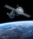 Spacecraft Soyuz Orbiting Earth. Stock Photo