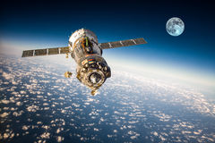 Spacecraft Soyuz over the planet earth. Spacecraft Soyuz orbiting the earth. Elements of this image furnished by NASA Royalty Free Stock Image