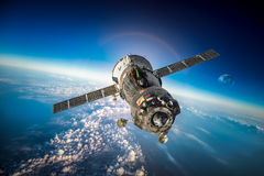 Spacecraft Soyuz over the planet earth. Spacecraft Soyuz orbiting the earth. Elements of this image furnished by NASA Royalty Free Stock Photos