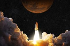 Spacecraft takes off into space. Rocket flies to Mars. Red planet Mars in space royalty free stock photos