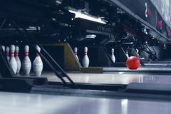 Spaced bowls and a rolling ball. Set skittles in the cells and a rolling ball with a shallow depth of field stock photo