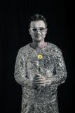 Ευτυχές spaceman με το λουλούδι Στοκ Εικόνες