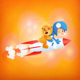 Spaceman boy with teddy bear on rocket Stock Photo