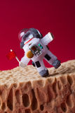 Spaceman explores Mars. Light bulb toy dressed in spacesuit and astronaut ammunition walking edge red planet landscape. Spaceman explores red planet Mars. Light Royalty Free Stock Photos