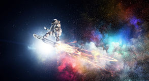 Spaceman on flying board. Mixed media royalty free stock photo