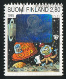Spaceman getting Letter. FINLAND - CIRCA 1995: stamp printed by Finland, shows Spaceman getting Letter, circa 1995 Royalty Free Stock Photography