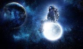 Astronaut sit on full moon. Mixed media Royalty Free Stock Photography