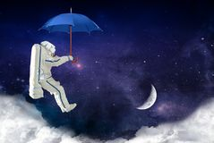 Spaceman with umbrella goes down to the moon. Elements of this image furnished by NASA stock illustration