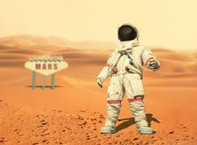 Spaceman walks on the red planet Mars. Space Mission. stock image