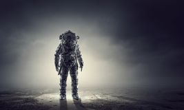 Space suit design. Mixed media. Spaceman wearing astronaut suit outdoor. Mixed media Stock Photo