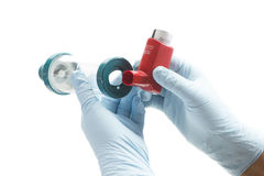 Spacer Chamber. Nurse attaches spacer chamber to asthma inhaler.  Albuterol is a common medication name Stock Image