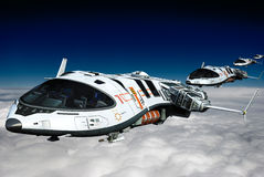 Spaceship above the clouds backside view Royalty Free Stock Photo