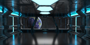 Spaceship interior with view on the planet Earth 3D rendering el. Spaceship blue interior with view on space and planet Earth 3D rendering elements of this image Royalty Free Stock Photo