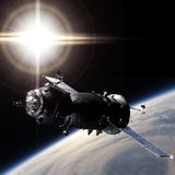 Spaceship on the orbit Stock Images