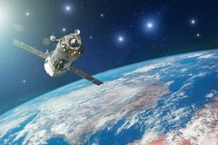 Spaceship piloted by astronauts in the orbit of planet Earth with bright stars. Elements of this image furnished by NASA.  royalty free stock image