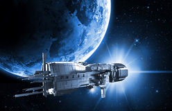 Spaceship with planet earth Stock Photography